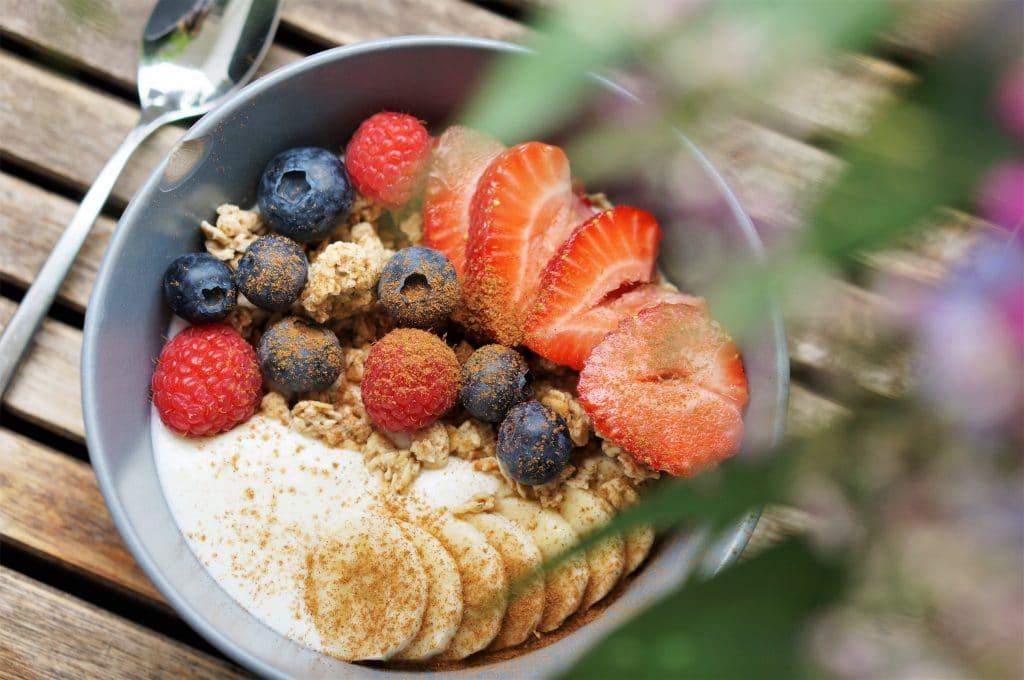 Yoghurt with fruits, granola and cinnamon